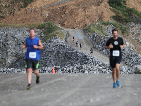 Runners in the Rock the Quarry Trail Challenge 5K, held in Grove Stone & Sand, descend into the mouth of the quarry. The race, which supports Black Mountain Home for Children and Asheville Museum of Science, returned for its 12th year on Sept. 14.