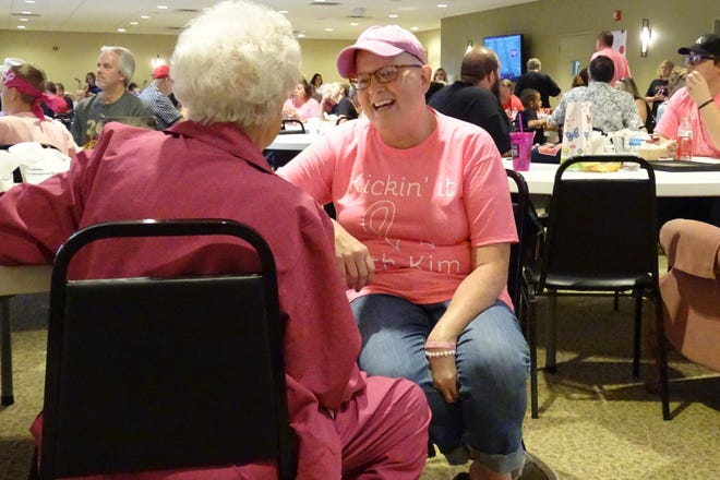 """Kim Rudd chats with a friend during the """"Kickin' it with Kim"""" benefit on Saturday at the Trillium Event Center."""