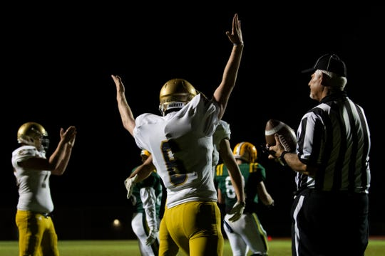 Essex quarterback Sam Bowen (6) celebrates the game winning touchdown in overtime during the high school football game between the BFA St. Albans Bobwhites and the Essex Hornets at Essex High School on Friday night September 13, 2019 in Essex, Vermont.