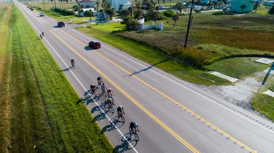 Cyclists peddle toward Corpus Christi on State Highway 361 during the 16th Conquer the Coast on Saturday, Sept. 14, 2019.