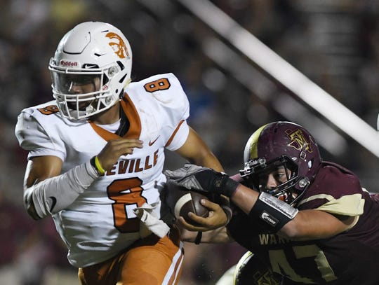 Beeville's Seth Gomez runs while Tuloso Midway's Mason Luna attempts to tackle, Friday, Sept. 13, 2019, at Warrior Stadium.