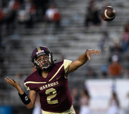 Tuloso Midway's J.D. Garcia throws a pass in the first quarter at the game against Beeville, Friday, Sept. 13, 2019, at Warrior Stadium.