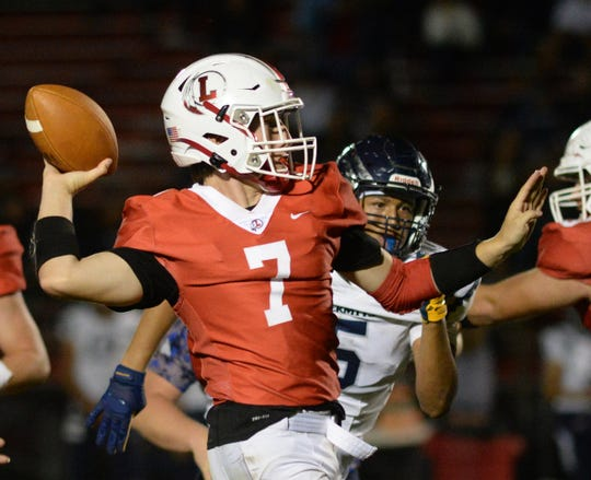 Lenape's Brady Long throws a pass during Friday night's football game against St. Augustine at Lenape High School, Friday, Sept. 13, 2019.