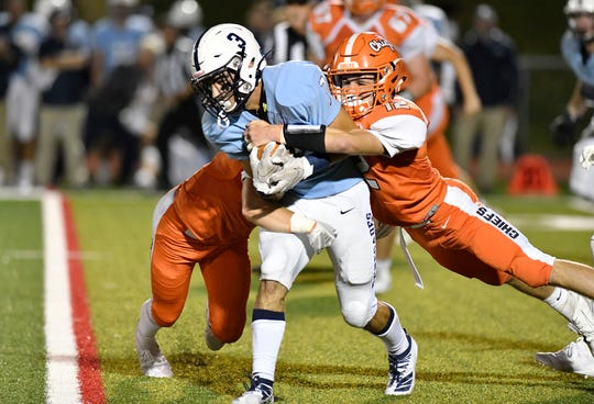 Shawnee's Dom Frigiola is brought down by Andrew Walters during a game against Cherokee on Friday, Sept. 13, 2019.
