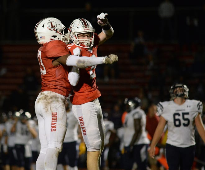 Lenape players celebrate a defensive stop during Friday night's football game against St. Augustine at Lenape High School, Friday, Sept. 13, 2019.