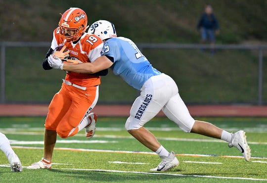 Shawnee's Matt Papa takes down Caden Burti during a game against Cherokee on Friday, Sept. 13, 2019.