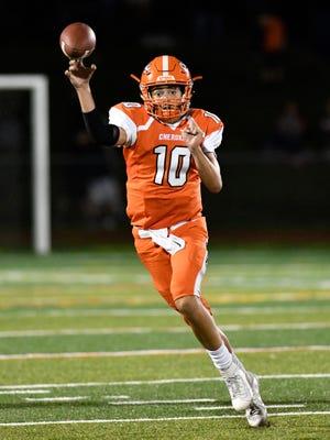Cherokee quarterback Billy Osborn throws for a gain against Shawnee.