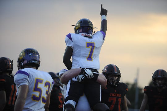 Unioto running back Jamarcus Carroll celebrates after scoring a touchdown in a 41-14 win over Waverly in Waverly, Ohio on Friday Sept. 13, 2019.