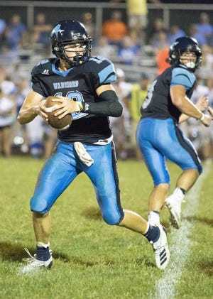 Adena quarterback Preston Sykes drops back during a 39-18 win over Washington in Frankfort, Ohio, on Sept. 13, 2019.