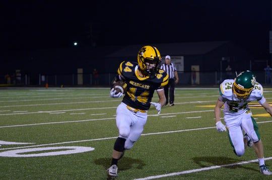 Paint Valley's Lane Mettler runs the ball during a 33-21 win over Newark Catholic at Paint Valley High School in Bainbridge, Ohio, on Sept. 13, 2019.