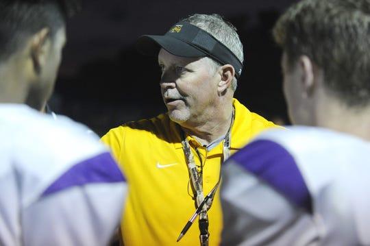 Unioto head coach Jeff Metzler talks to team during Unioto's 41-14 win over Waverly in Waverly, Ohio on Friday Sept. 13, 2019.