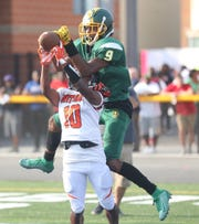 Taft wide receiver Gianni Rudolph (9) tries to catch a pass over Tyrese Captain of Withrow on Friday, Sept. 13, 2019.