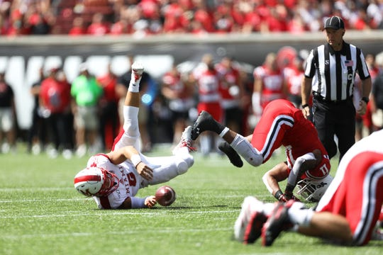 Miami (Oh) Redhawks quarterback Brett Gabbert (5) is sacked for a fumble by Cincinnati Bearcats linebacker Bryan Wright (11) in the first half of the NCAA football game between the between the Cincinnati Bearcats and the Miami (Oh) Redhawks at Nippert Stadium in Cincinnati Saturday, Sept. 14, 2019.