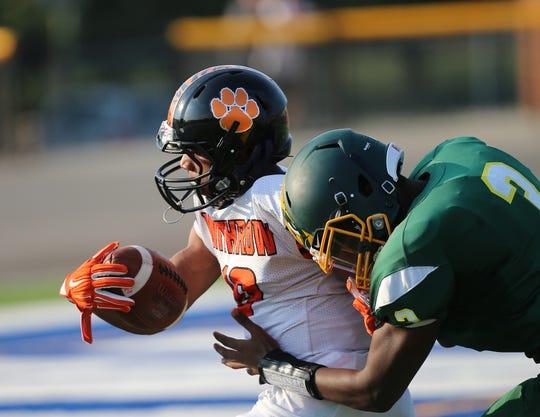 Withdraw wide receiver Tyrese Captain (10)  is tackled by Taft defensive back Robert Brazziel (3) during their football game Friday, Sept.13, 2019.