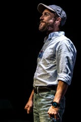 """Nathan Tubbs plays Glenn, the intergalactic telemarketer in """"The Absentee,"""" at the Know Theatre through Oct. 5, 2019."""