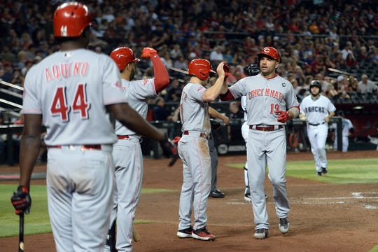 Sep 13, 2019; Phoenix, AZ, USA; Cincinnati Reds first baseman Joey Votto (19) celebrates with teammates after hitting a two run home run against the Arizona Diamondbacks during the third inning at Chase Field. Mandatory Credit: Joe Camporeale-USA TODAY Sports