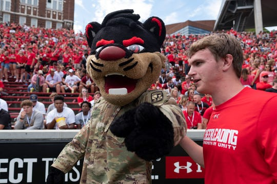 The mascot for the Cincinnati Bearcats wears a military uniform on military appreciation day in the second half of the NCAA football game between the between the Cincinnati Bearcats and the Miami (Oh) Redhawks at Nippert Stadium in Cincinnati Saturday, Sept. 14, 2019.