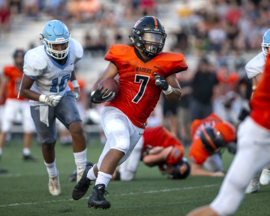 Ryle running back Kyle England scores a touchdown against Boone County during  their football game on Friday, Sept. 13, 2019.