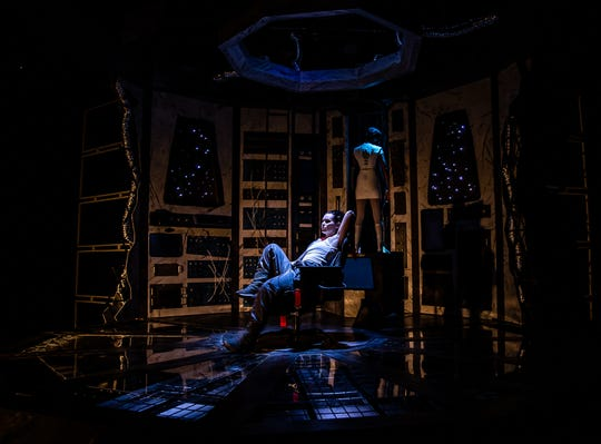 """Jordan Trovillion (foreground) stars as the operator in the Know Theatre's production of Julia Doolittle's """"The Absentee.""""  In the background is A. J. Baldwin as an android named beacon. The production runs through Oct. 5, 2019."""