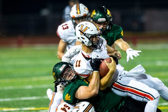 West Des Moines Valley quarterback Braeden Katcher (11) gets tackled by Cedar Rapids Kennedy's Cade Parker (35) during a Class 4A varsity football game, Friday, Sept. 13, 2019, at Kingston Stadium in Cedar Rapids, Iowa.