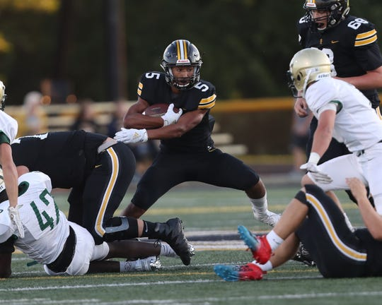 Sept 13, 2019; Pleasant Hill, IA, USA; Southeast Polk Rams Xavier Nwankpa breaks a tackle against the Iowa City West Trojans at Southeast Polk High School. The Rams beat the Trojans 23 to 21.  Mandatory Credit: Reese Strickland-For the Herald