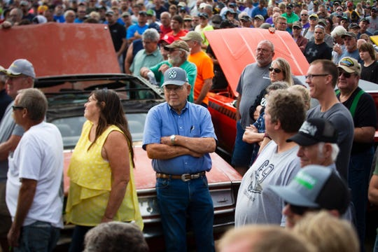 Onlookers attend the Coyote Johnson Vanderbrink Car Auction on Sept. 14, 2019 in Red Oak, Ia. Coyote Johnson of Red Oak has collected over 90 muscle cars since age 16, and kept a select few models following the auction.