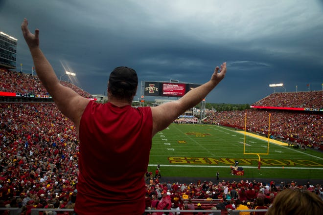 Fans cheer as a second lightning strike caused a delay in the first half of the Cy-Hawk football game at Jack Trice Stadium on Saturday, Sept. 14, 2019 in Ames.