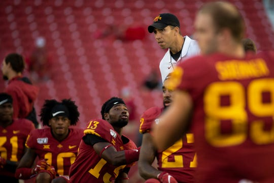Iowa State head coach Matt Campbell shakes hands with his players during the Cy-Hawk football game at Jack Trice Stadium on Saturday, Sept. 14, 2019 in Ames. A lightning strike forced a delay in the first quarter.