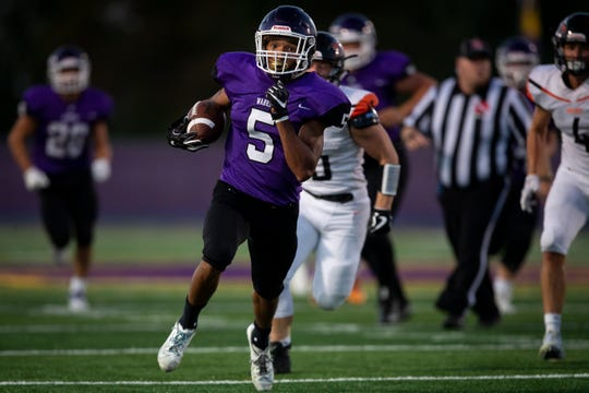 Waukee's Aaron Smith (5) breaks open a run for a touchdown to make the score 13-0 during their football game on Friday, Sept. 13, 2019 in Waukee. Waukee took a 20-0 lead over Cedar Rapids, Prairie into halftime.