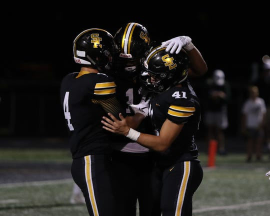 Sept 13, 2019; Pleasant Hill, IA, USA; Southeast Polk Rams celebrate the win against the Iowa City West Trojans at Southeast Polk High School. The Rams beat the Trojans 23 to 21.  Mandatory Credit: Reese Strickland-For the Herald