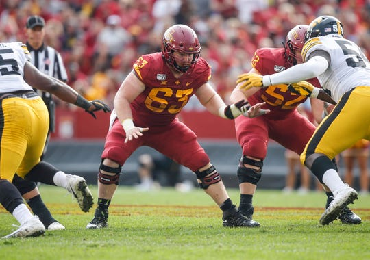 Iowa State senior offensive lineman Collin Olson (No. 63) makes a presence during a play in the second quarter against Iowa on Saturday, Sept. 14, 2019, at Jack Trice Stadium in Ames.