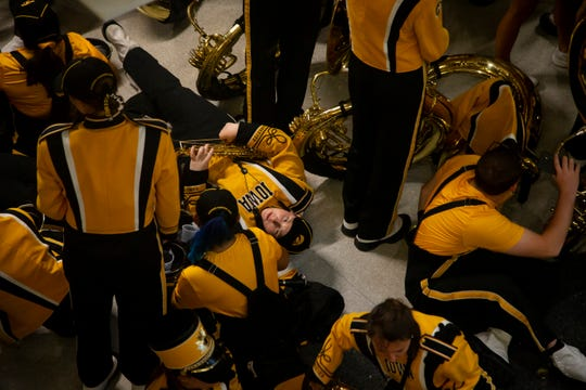 The Iowa Marching band takes a refuge from the storm inside the Jacobsen building during the Cy-Hawk football game at Jack Trice Stadium on Saturday, Sept. 14, 2019 in Ames.