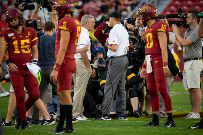 Iowa State head coach Matt Campbell, right, and Iowa  head coach Kirk Ferentz, left, talk before the game during the Cy-Hawk football game at Jack Trice Stadium on Saturday, Sept. 14, 2019 in Ames.