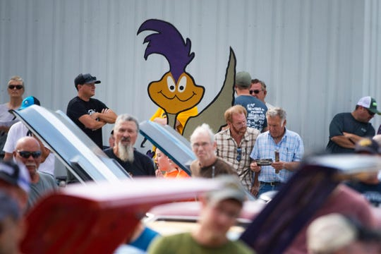 A cutout of a Plymouth Roadrunner mascot is seen at the Vanderbrink Car Auction on Sept. 14, 2019 in Red Oak, Ia.