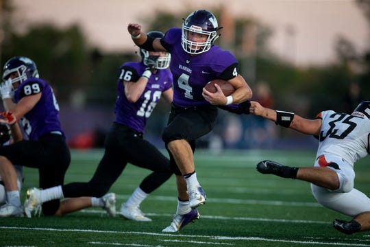 Waukee's Mitch Randall (4) avoids the tackle of Cedar Rapid, Prairie's Clayton Scott (35) during their football game on Friday, Sept. 13, 2019 in Waukee. Waukee took a 20-0 lead over Cedar Rapids, Prairie into halftime.