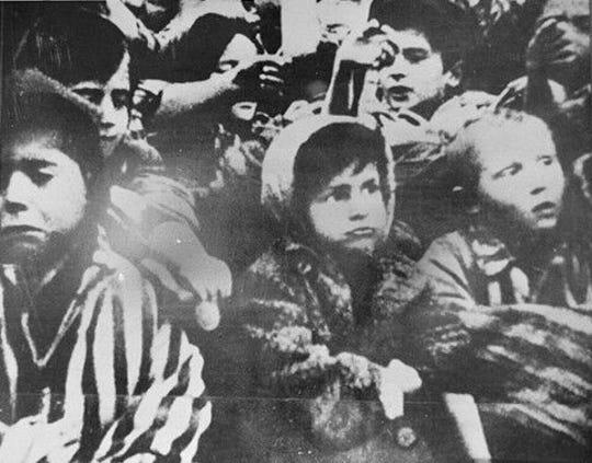 Bornstein in Auschwitz as a child.