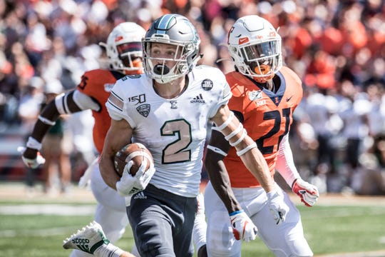 Eastern Michigan's Matthew Sexton heads to the end zone vs. Illinois in the first half, Saturday, in Champaign, Ill.