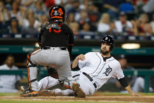 Jordy Mercer is tagged out at home plate by Orioles catcher Chance Sisco during the fourth inning Friday.