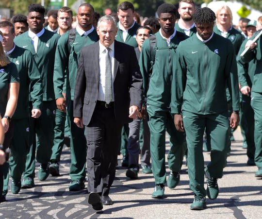 Michigan State coach Mark Dantonio leads his team to the stadium before the game against the Arizona State Sun Devils, Saturday, Sept. 14, 2019 at Spartan Stadium.