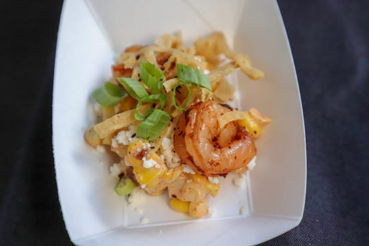 A shrimp dish is served with Mexican garnishes at Detroit Ghost Gray booth, during Detroit Free Press Food Experience and Wine in Capital Park in the center of Detroit Saturday, September 14, 2019.