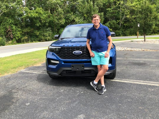 Stephen Shaffer has owned a 2020 Ford Explorer ST for five weeks and he loves it. But the air-conditioning blew hot air on the passenger side and cold air on the driver's side, illustrating an issue with the early production vehicles. He is pictured here Sept. 14, 2019 in Rehoboth Beach, Delaware.