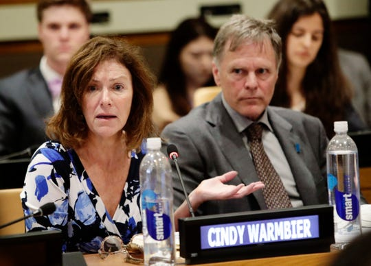 Fred Warmbier, right, listens as his wife Cindy Warmbier, speaks of their son Otto Warmbier, an American who died in 2017 days after his release from captivity in North Korea, during a meeting at the United Nations headquarters on May 3, 2018.