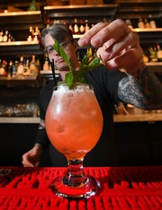 Grandma Bob's Hamdmade Pizza bar manager Scott Poole makes a Snap Dragon consisting of Cabresto Silver Tequila, strawberry syrup, lime and Rose' Lambrusco.