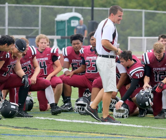 Elmira head coach Jimmy McCauley talks to his players after their 63-13 win over Union-Endicott on Sept. 14, 2019 at Ernie Davis Academy's Marty Harrigan Athletic Field.
