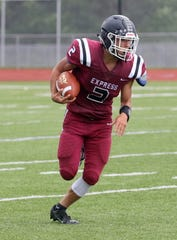 Ethan Simpson of Elmira picks up a big game in a 63-13 victory over Union-Endicott on Sept. 14, 2019 at Ernie Davis Academy's Marty Harrigan Athletic Field.