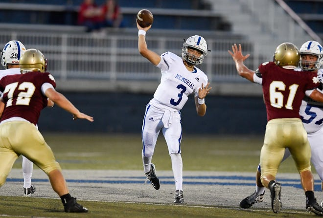 Memorial quarterback Colton Pence (3) passes down field in the SIAC battle of the unbeatens as the Memorial Tigers play the Mater Dei Wildcats at the Reitz Bowl Friday evening, September 13, 2019.