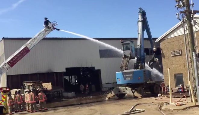 Evansville firefighters douse a fire at an industrial property fire at 1550 Grove St. on the West Side.