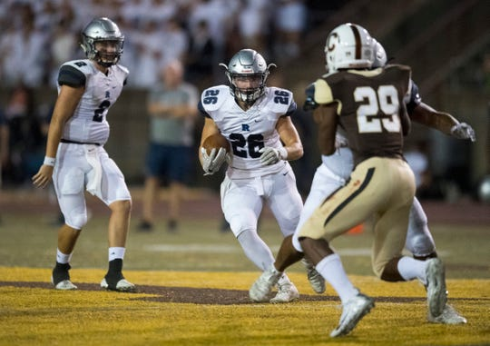 Reitz's Collin Brown (26) carries the ball during the Central Bears vs Reitz Panthers game Friday evening, Sept. 13, 2019.