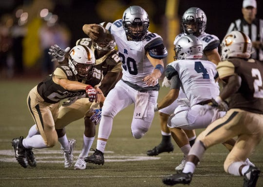 Reitz's Alex Mitchell (30) carries the ball during the Central Bears vs Reitz Panthers game Friday evening, Sept. 13, 2019.
