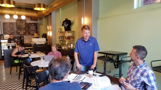 Casey Todd, chef and owner of Hometown Roots and Roast Coffee Bar, chats with customers in Roast on Friday, Sept. 13, 2019.